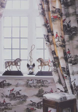 Lewis and Wood -  Lewis And Wood Fabric Collection - Grey, white and red hunting themed curtains, wallpaper, and a seat to a padded wooden stool,with two horse sculptures