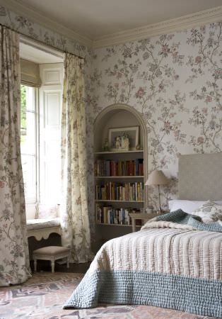 Lewis and Wood -  Lewis And Wood Fabric Collection - Grey and white floral patterned wallpaper and curtains, andlight blue and off-white bedding with a pale grey headboard