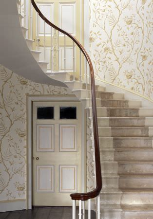 Lewis and Wood -  Lewis And Wood Fabric Collection - Cream and white colours making up doors, a staircase and floral and branch patterned wallpaper