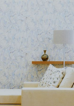 Lewis and Wood -  Lewis And Wood Fabric Collection - Marbled pale blue and white wallpaper, a wooden shelf, a white lamp, a vase, a white chaise longue and a patterned cushion