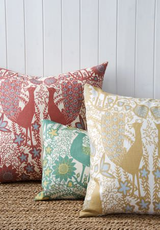 Lewis and Wood -  Lewis And Wood Fabric Collection - Three stylised peacock print patterned cushions in white, with designs in red, pale blue, gold and two shades of green