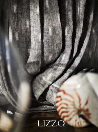 Lizzo -  Aroma Fabric Collection - Draped grey fabric flecked with white, with a sea shell and a glass vase