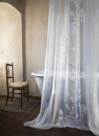 Lizzo -  Capri Fabric Collection - White voile featuring a large, white flower and vine design running up the centre, a rolltop bath, with a wooden framed chair with gold seat