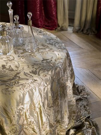 Lizzo -  Ducale Fabric Collection - High quality cream satin effect fabric covered in detailed silver and cream embroidery, with shaped glass decanters and bottles