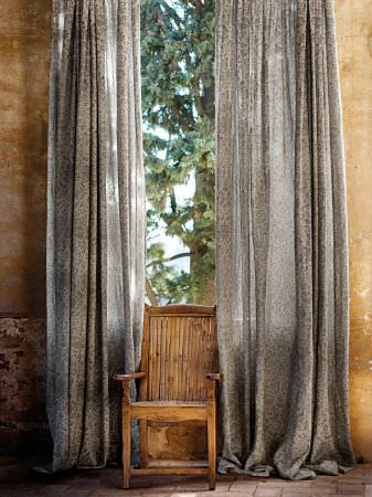 Lizzo -  Forest Fabric Collection - Chair made from plain wood, with strips of wood making up the back, with long grey curtains featuring a small, dark grey pattern