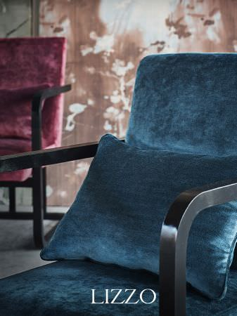 Lizzo -  Ikebana Fabric Collection - 1 red and 1 blue armchair, both with arms and legs made from a single piece of black wood, both in velour fabric, with 1 blue velour cushion