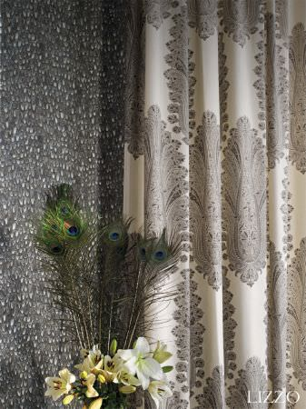 Lizzo -  Mata Hari Fabric Collection - Grey fabric with small grey and white cobble effect pattern, with cream fabric with a repeated large grey peacock feather style design