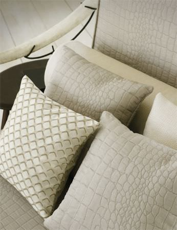 Lizzo -  Mimic Fabric Collection - Chair with wooden arm and grey reptile skin print padding, two matching cushions, a white cushion and a cushion with a small square print