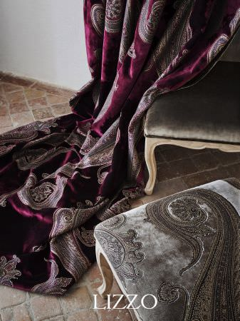 Lizzo -  Opera Fabric Collection - Bold pink and gold flower print curtains with various patterned cushions and black upholstered sofa