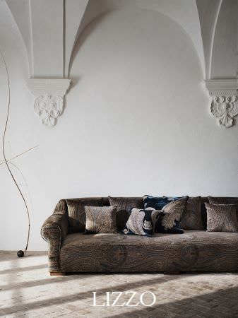 Lizzo -  Opera Fabric Collection - Wide sofa upholstered in very detailed dark brown patterned fabric, with matching cushions, and blue velour cushions with paisley embroidery