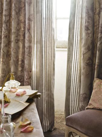 Lizzo -  Provenza Fabric Collection - Purple padded wooden chair in front of a solid wood table, with a pale pink patterned cushion, gold floral curtains and striped curtains