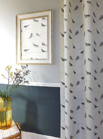 Louise Body -  Collection One Fabric Collection - Fabric made in light grey shades with a bird print, made into curtains and framed artwork, with a yellow vase and a stool