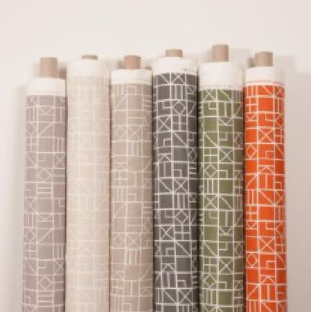 Natasha Marshall -  Alegre Fabric Collection - White geometric shapes on six bolts of fabric with backgrounds in olive green, orange and four different shades of grey