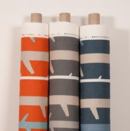 Natasha Marshall -  Alegre Fabric Collection - Branch designs creating a simple pattern on three bolts of fabric in orange, charcoal, denim blue, beige and white