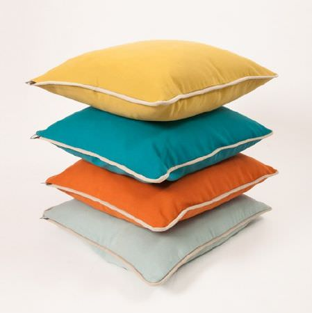 Natasha Marshall -  Alibi Woven Fabric Collection - A stack of four square scatter cushions, made in plain shades of mustard yellow, aquamarine, bright orange and pale blue