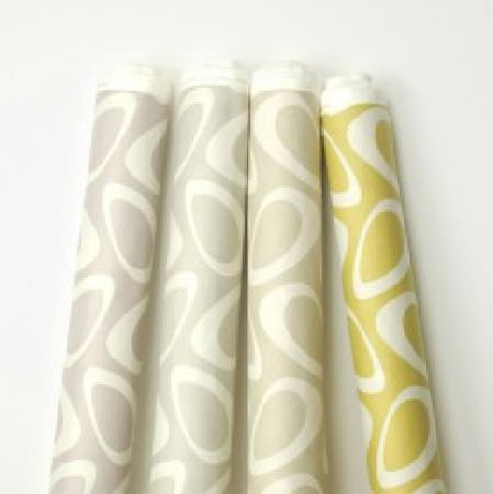 Natasha Marshall -  Ikon Print Fabric Collection - Four bolts of fabric made in green-gold and three light shades of grey, all featuring a white retro circle pattern