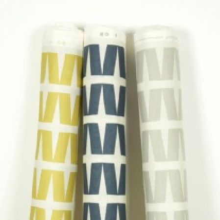 Natasha Marshall -  Ikon Print Fabric Collection - 3 bolts of white fabric, all with a pattern of rows of slanting rectangles, 1 in light gold, 1 in navy, and 1 in pale grey