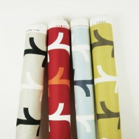 Natasha Marshall -  Ikon Print Fabric Collection - Stylised branch designs printed on four bolts of fabric in colours such as white, black, grey, red, orange, blue and green