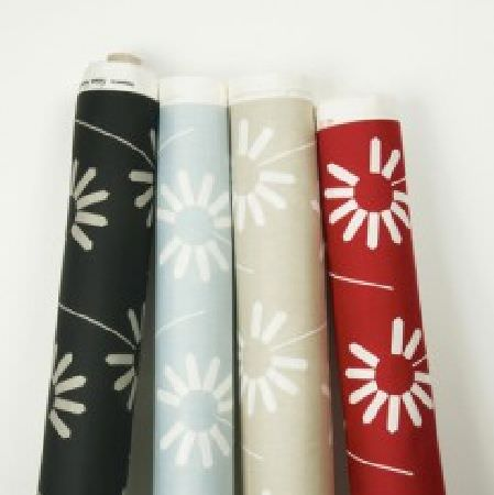 Natasha Marshall -  Ikon Print Fabric Collection - Four bolts of fabric featuring white stylised flower patterns on plain black, baby blue, pale grey and red backgrounds