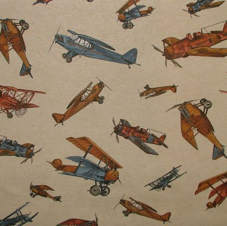 Novelty -  Linen Look Fabric Collection - Gold, dusky blue and dark orange propellor planes and biplanes printed on dark beige fabric
