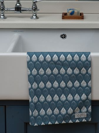 Ochre and Ocre -  Ochre and Ocre Fabric Collection - A large double butler sink with silver taps and marine blue cupboard doors, and blue and white teardrop patterned fabric