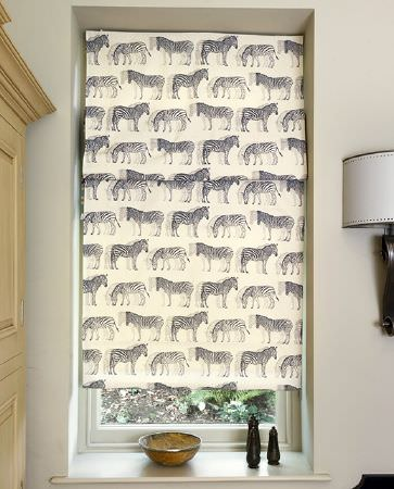 Olivia Bard -  Curious World Fabric Collection - Interesting roman blinds in colour white decorated with a big pattern of zebras in colour black