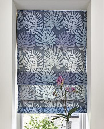 Olivia Bard -  Curious World Fabric Collection - Transparent roman blinds dyed in dark shade of blue and decorated with a big pattern of leaves
