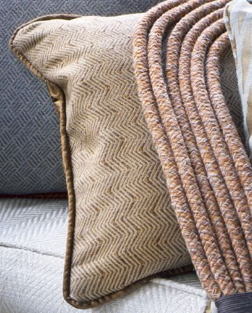 Olivia Bard -  Curious World Fabric Collection - Brown cushion decorated with light beige threaded pattern of zigzag lines and with brown borders