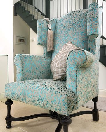 Olivia Bard -  Do Decadence Fabric Collection - Large upholstered armchair with dark brown wooden legs dyed in colour beige with shiny aqua blue decorations