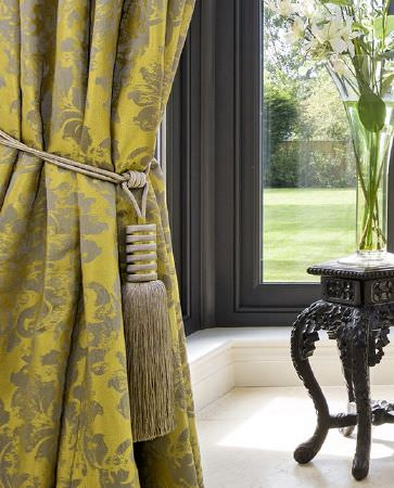 Olivia Bard -  Do Decadence Fabric Collection - Vibrant yellow curtain featuring elegant floral design in beige and a curtain tie back in beige and yellow