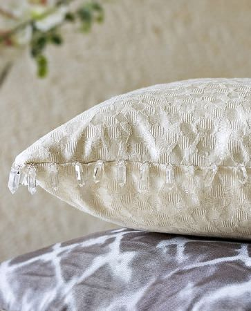 Olivia Bard -  Do Decadence Fabric Collection - Light beige cushion featuring elegant design and small hanging crystals sewn on the edges of the cushion