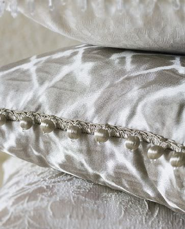 Olivia Bard -  Do Decadence Fabric Collection - Elegant silver cushion decorated with conventional pattern in white with silky pompoms on the borders