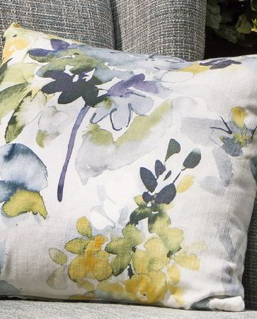 Olivia Bard -  Tamed Spirit Fabric Collection - Close view of a modern cushion in white decorated with vibrant watercolour floral pattern