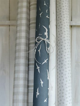 Peony and Sage -  Coastal Fabric Collection - Dark blue and white bird print fabric, with checked, striped, bird print and star print fabric, all in grey-beige and white