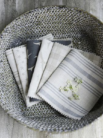 Peony and Sage -  Coastal Fabric Collection - Dark grey and white weave effect bowl holding dark blue-grey, beige, grey and white checked, striped and patterned fabrics