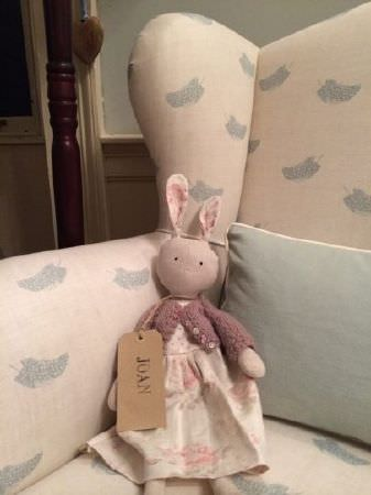 Peony and Sage -  Country Life Fabric Collection - Cream and light grey feather print fabric armchair with a small plain pale blue cushion and a stuffed toy rabbit