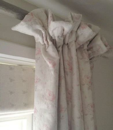 Peony and Sage -  Country Life Fabric Collection - Subtle floral patterns on pink, grey and white curtains on a grey curtain pole, with a grey and white bee print blind