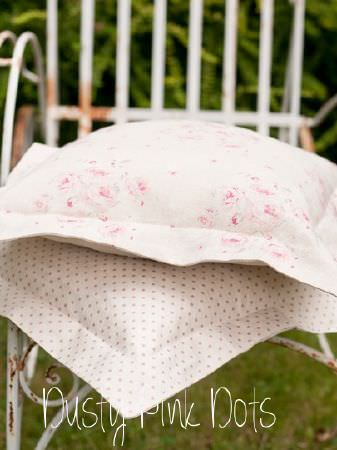 Peony and Sage -  Country Life Fabric Collection - A rusty white metal chair with two large pink and white cushions; one with polka dots, the other with a floral print