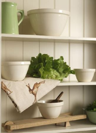 Peony and Sage -  Country Life Fabric Collection - A cream shelving unit with cream bowls, a green jug and fabric made with a hare print in off-white and shades of brown