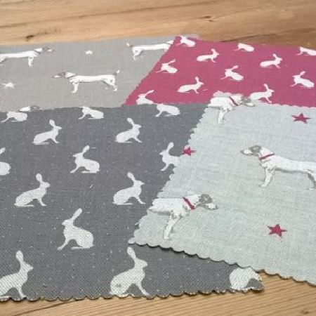 Peony and Sage -  Country Life Fabric Collection - Four swatches of fabric featuring dog and star prints and hare silhouettes, all in white, maroon and grey shades