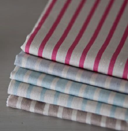 Peony and Sage -  Country Life Fabric Collection - White and dark pink, white and pale blue,white and sky blue, and white and grey striped fabrics in a stack of five