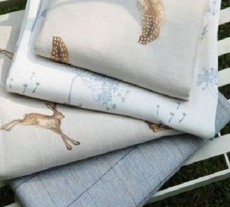 Peony and Sage -  Country Life Fabric Collection - Folds of fabric in light shades of grey, brown, white and blue, with checks, hares, flowers and feather prints
