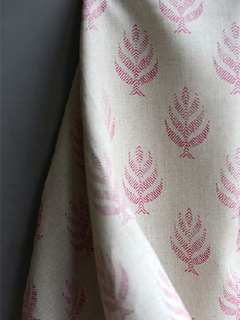 Peony and Sage -  Finca Fabric Collection - Small, simple dark pink stylised leaf style patterns made up of thin lines, printed on a swathe of light grey fabric