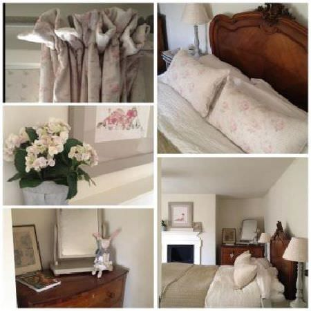 Peony and Sage -  French Florals Fabric Collection - A wooden bed and chest of drawers withpale pink and grey floral curtains and cushions, beige bedding, and cream flowers