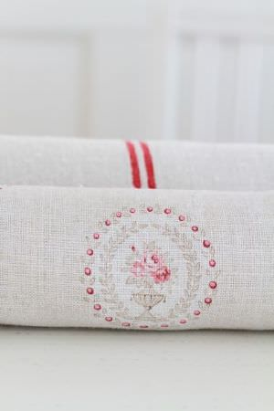 Peony and Sage -  French Florals Fabric Collection - 2 rolls of off-white fabric, one with 2 closely spaced bright red lines, the other with a circular floral and dot design