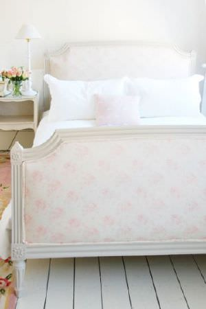Peony and Sage -  French Florals Fabric Collection - Bright white bedding on a bed with a white wood frame and asubtly patterned pale pink and white headboard and footboard