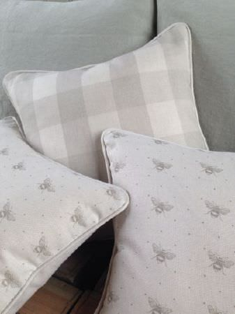 Peony and Sage -  French Florals Fabric Collection - Two plain light grey cushions, with three light grey and white cushions featuring simple checks and small bee and dot prints