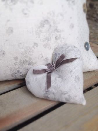 Peony and Sage -  French Florals Fabric Collection - Dark grey velvet ribbon and buttons accessorizing a padded heart and cushion, both covered with light grey and white florals