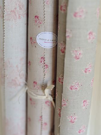 Peony and Sage -  French Florals Fabric Collection - 3 scrolls of floral patterned fabrics, made with small designs in light shades of grey and pink, tied with cream ribbon