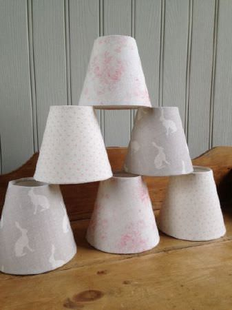 Peony and Sage -  French Florals Fabric Collection - A pyramid of 6 lampshades covered with floral, hare and polka dot prints in off-white and light shades of grey and pink